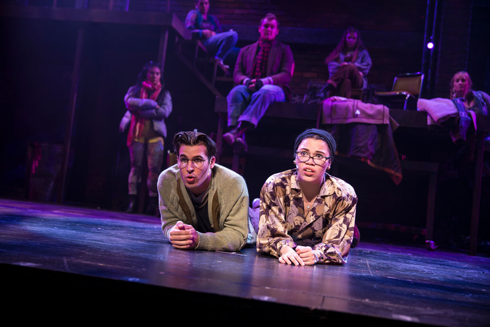 Cornell students perform Rent on stage.